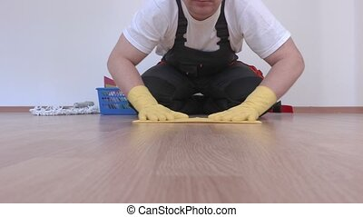 Cleaner polished and checking furniture surface