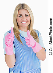 Cleaner putting thumbs up with pink gloves