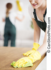 Cleaner woman with yellow gloves