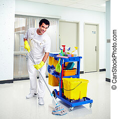 Cleaner. - Young professional cleaner washing the floor....