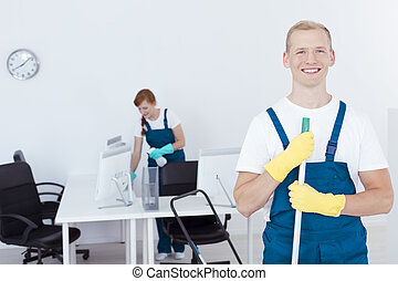 Cleaners during work - Young cleaners during their work in a...