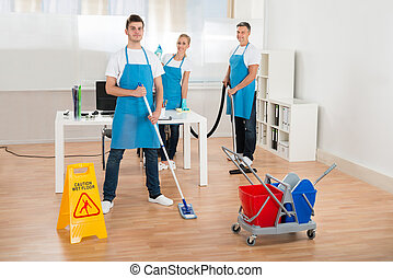 Cleaners Team Cleaning Floor