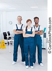 Cleaners wearing uniforms - Young smiling cleaners wearing...