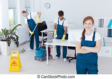 Cleaners working in office - Group of young cleaners working...