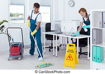 Cleaners working in uniforms - Group of young cleaners...