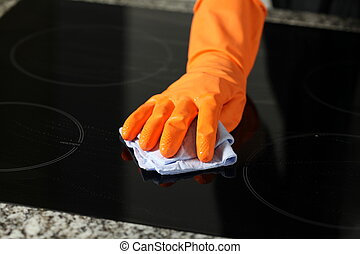 Cleaning a cooker - Closeup of cleaning a cooker with rubber