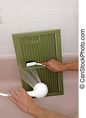 Cleaning an Air Return Vent - A large painted green home air...