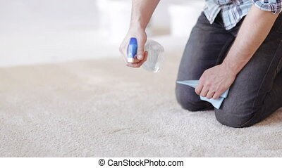 close up of male cleaning stain on carpet - cleaning and ...