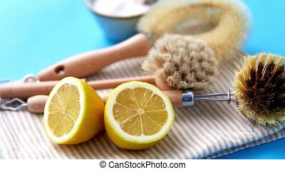 cleaning brushes, lemon and washing soda on cloth - natural ...