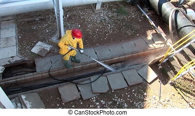 Cleaning cable conduct with high pressure hose