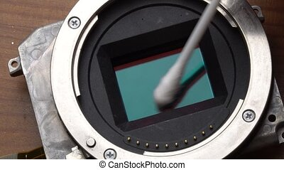 Cleaning camera's sensor - Macro closeup of cleaning...