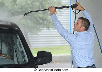 cleaning car using high pressure water