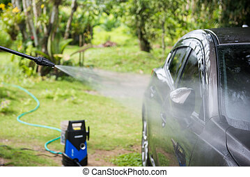 Cleaning car with high pressure water