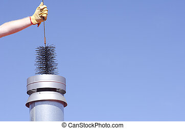 Cleaning chimney with sweeper sky background - Arm with...