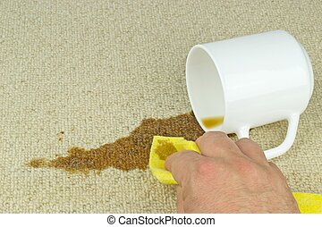 Cleaning Coffee Stain from Carpet - A hand with cloth...
