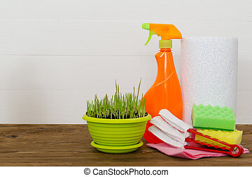 Cleaning concept with supplies on white wooden background