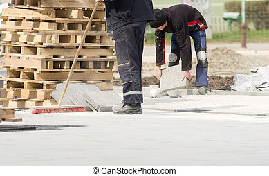 Cleaning construction site - Construction worker in safety ...