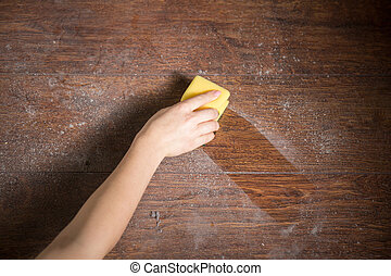 Cleaning dust from the wood in house