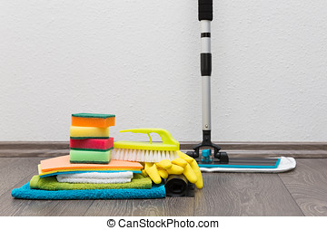 cleaning equipment on the floor against white wall