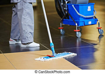cleaning floor - cleaner with mop and uniform cleaning hall ...