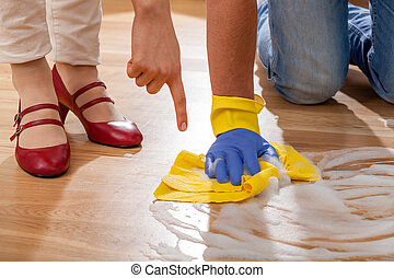 Cleaning floor - Wife learning her husband cleaning floor in...