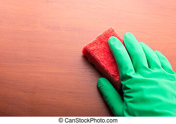 Cleaning glove with a sponge