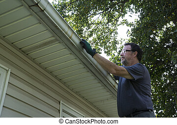 Cleaning Gutters Of Leaves And Sticks