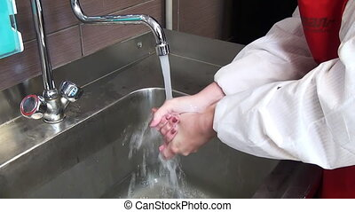 Cleaning hands with detergent.