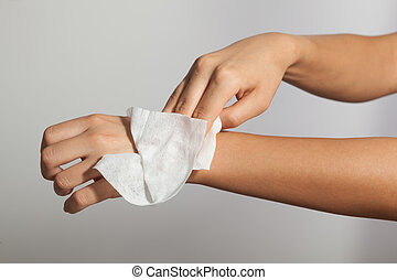 Cleaning hands with wet wipes