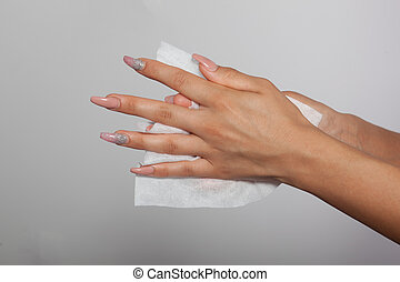 Cleaning hands with white wet wipes