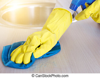 Cleaning kitchen countertop - Close up of female hands with...