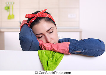 Cleaning lady sleeping - Young tired cleaning lady falling...