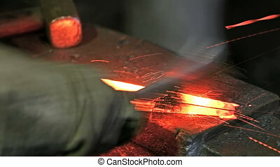 Cleaning of metal part with a metal brush in the blacksmith...