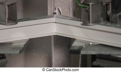 Cleaning of welds on a plastic window. - Cleaning of welds...