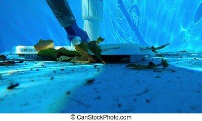 Underwater view of vacuum cleaner at bottom of swimming pool.