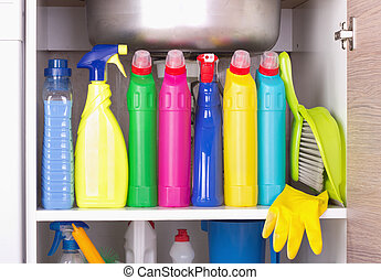Cleaning product storage space - Cleaning products placed in...