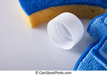Cleaning products on white table close up