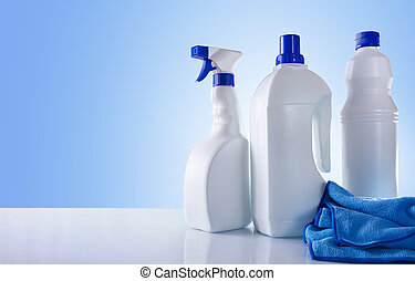 Cleaning products on white table overview