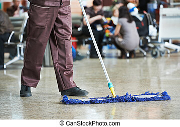 cleaning public hall floor - cleaner with mop and uniform...