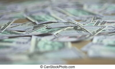 cleaning scattered bills from the floor close up