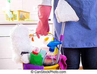 Cleaning service concept - Cleaning lady with apron and...