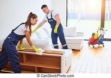 Cleaning service staff work together in cottage