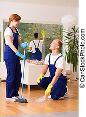 Cleaning service sweeping floor