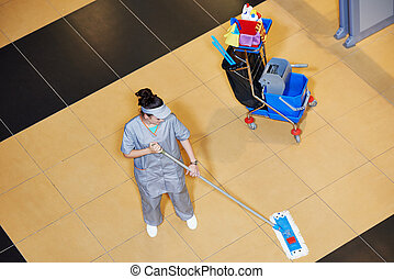 cleaning services - female cleaner with mop and uniform...
