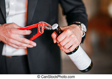 Cleaning shoes on wooden background. black shoe with a brush. Red adjustable wrench. Wedding rings. beer bottle. Wood box and firewood