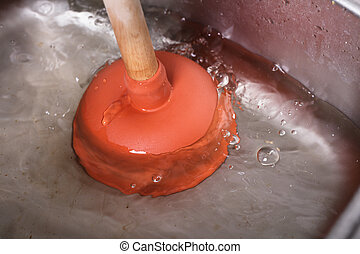 Cleaning Sink With Cup Plunger - An Orange Cup Plunger In...