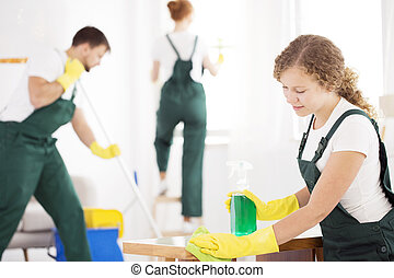 Cleaning specialist woman using detergent