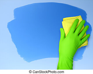cleaning - Hand in rubber glove wiping cloth surface