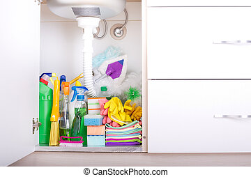 Cleaning supplies in kitchen cabinet - Set of cleaning...