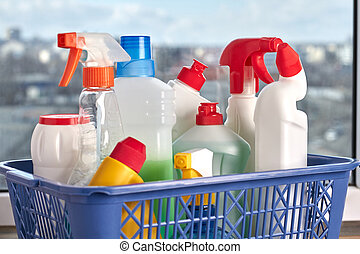 Cleaning supplies on wooden background.